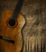 Acoustic brown guitar against a grunge brown background